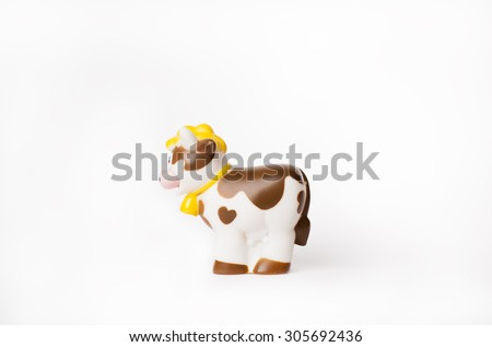 toy cow isolated - stock photo