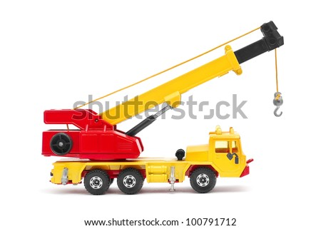 toy crane on white background - stock photo