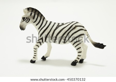 Toy deer made of plastic on a white background - stock photo