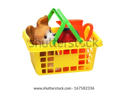 toy dog ball pitcher in pediatric plastic basket                                - stock photo
