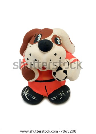 Toy Dog - soccer player with ball, isolated on white - stock photo
