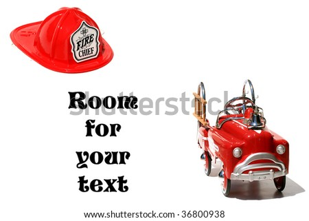 "toy fireman helmet and pedal car fire truck ""isolated on white"" with ""room for your text"""