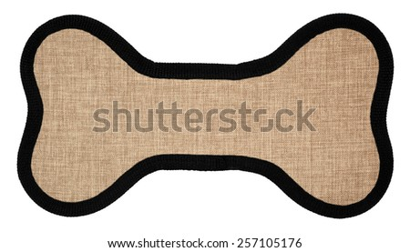 Toy for pets shaped as dog bone - stock photo
