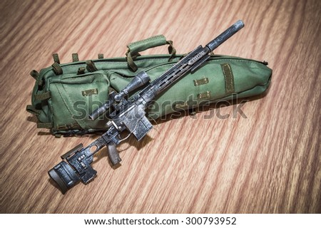 toy gun and weapons and toy scale on woods texture and woods backgrounds - stock photo