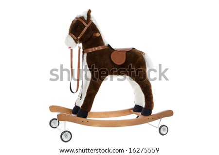 toy horse with a saddle and wheels - stock photo