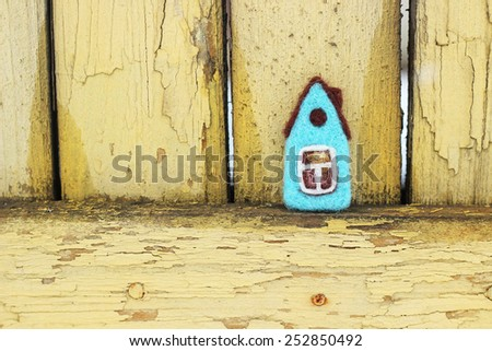 toy house on yellow vintage background - stock photo