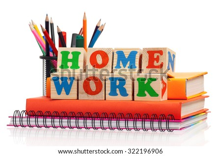 Toy letters that spell homework and books over white background - stock photo