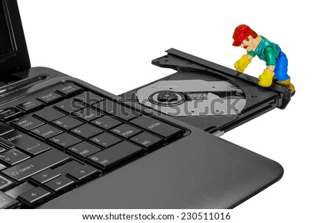 toy man repairing a laptop, warranty, service center, isolate - stock photo