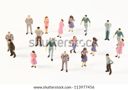 Toy, miniature figures of human in costumes, view from above - stock photo