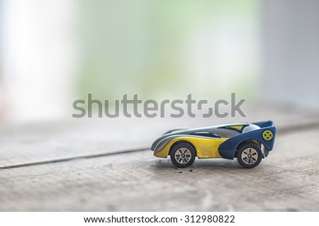 Toy model of modern car in nursery room - stock photo