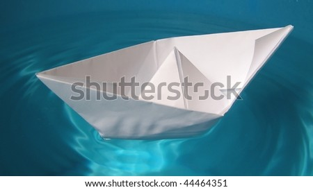 Toy paper ship in real water pond - (16:9 ratio)