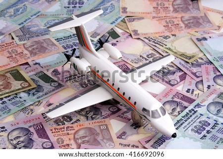 Toy plane on Indian currency notes - stock photo