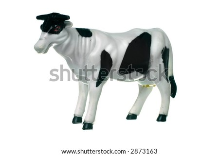 toy plastic cow, isolated on white ground - stock photo