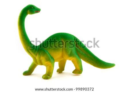 Toy plastic dinosaur over white - stock photo