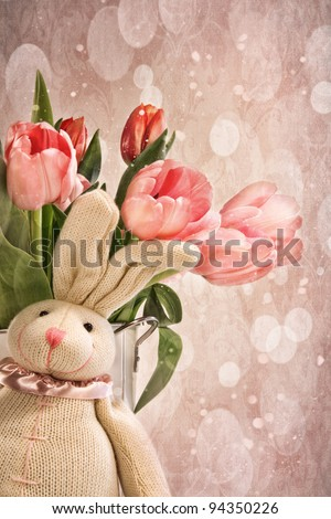 Toy rabbit with pink tulips for Easter - stock photo
