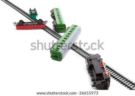 Toy railroad train crash -  locomotive and wagons off the rails - stock photo