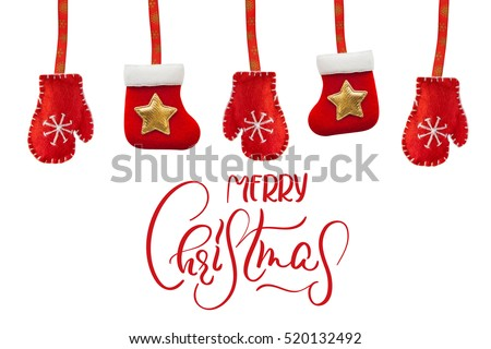 toy red boots and gloves isolated on a white background with text Merry Christmas. Calligraphy lettering