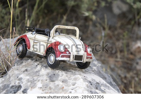Toy retro car - a symbol of travel and adventure