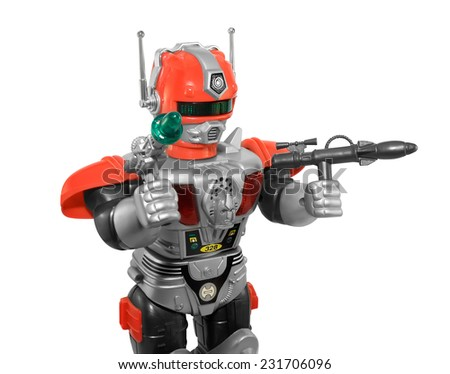 Toy robot closeup. Isolated armored plastic silver red toy robot with guns, closeup view.