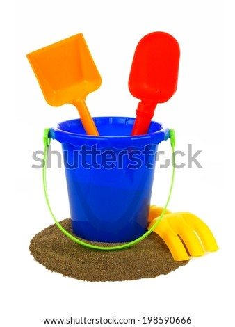 Toy sand pail with shovels and rake over a white background - stock photo