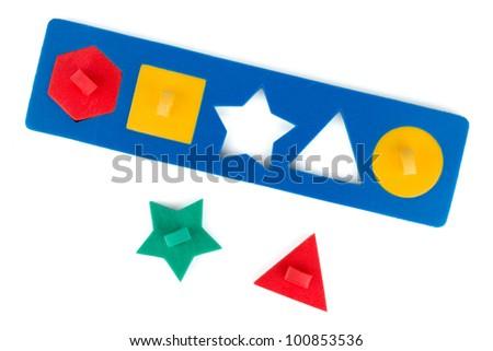 Toy shape puzzle. Isolated on white background - stock photo