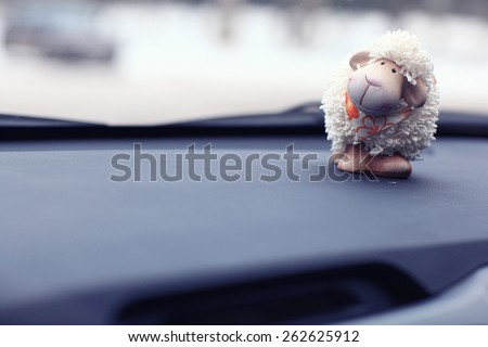 toy sheep background car panel - stock photo