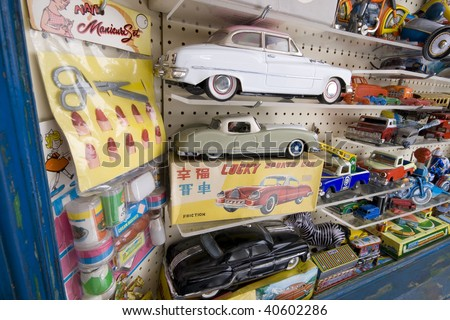 Toy shop window close up of tin plate and other retro toys and games. - stock photo