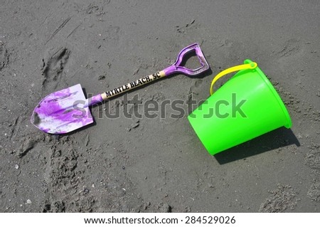 Toy shovel and beach bucket - stock photo