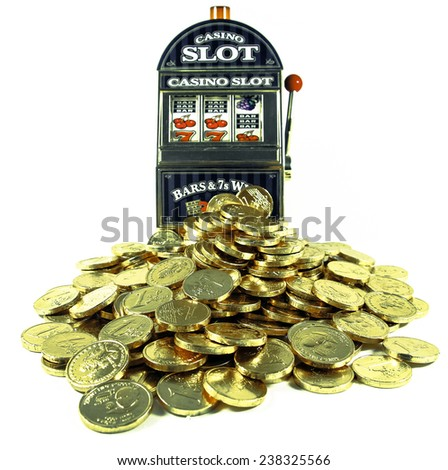 toy slot Machine and toy money - stock photo