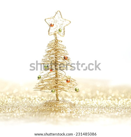 Toy small Christmas tree with decoration on white background - stock photo