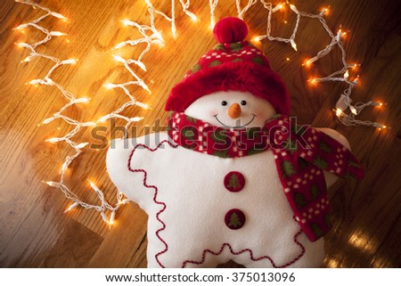 Toy Snowman and White Christmas Lights - stock photo