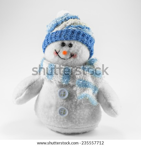 toy snowman on it blue hat and scarf - stock photo