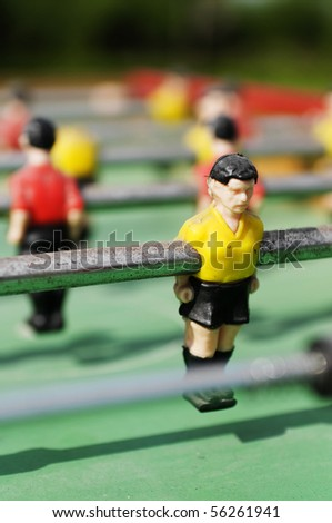 Toy soccer players on the field - stock photo