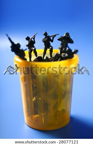 Toy soldiers row on the trash, end of war metaphor, peace - stock photo