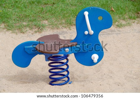Toy spring horse outdoor - stock photo