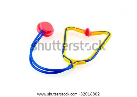 Toy stethoscope on white background - stock photo