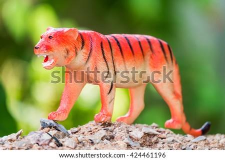 Toy Tiger on Soil - stock photo