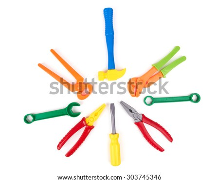toy tools plastic color isolated on a white background - stock photo