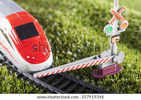 Toy train stopped by bar, horizontal image - stock photo