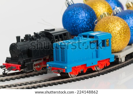 Toy trains driven by Christmas decorations. - stock photo