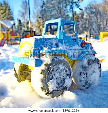 Toy vehicle in snow - stock photo