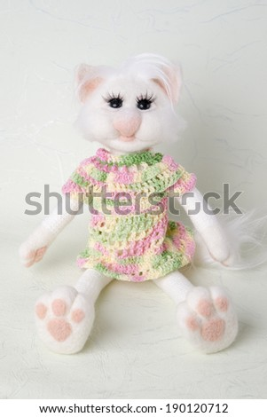 Toy white cat. Gift for holiday. Handmade Felt. - stock photo