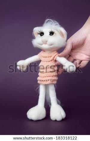 Toy white cat on purple background. Gift for holiday. Handmade Felt. - stock photo