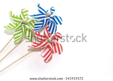 Toy windmills on white background (2) - stock photo
