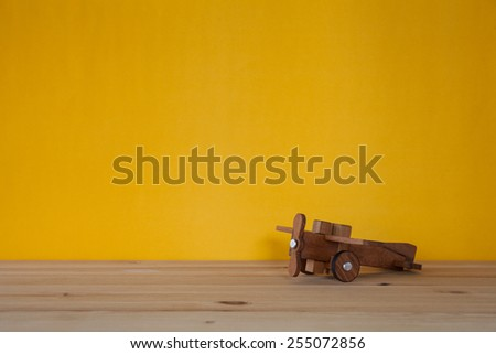 Toy wooden airplane - stock photo