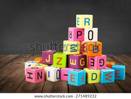 Toy. Wooden toy cubes with letters. Wooden alphabet blocks. - stock photo