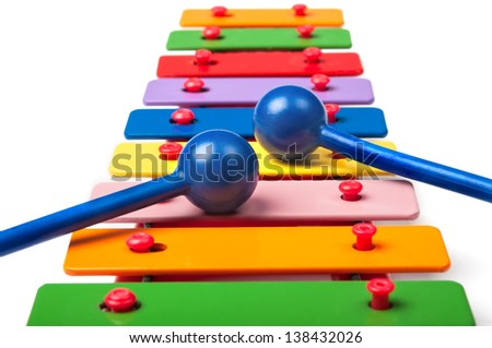 Toy xylophone on white background - stock photo