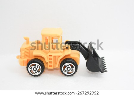 Toy Yellow tractor on white background