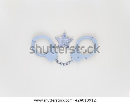 Toys, handcuffs, badge , sheriff - stock photo