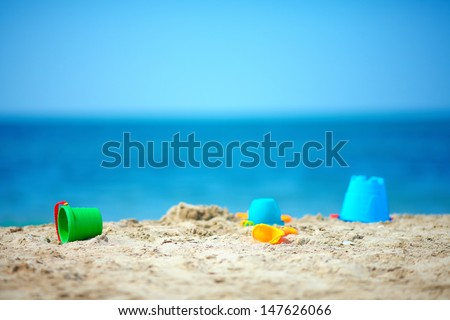 toys on summer beach - stock photo